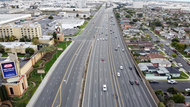 General overall view of sparse traffic on the Interstate 5 near the Citadel Outlets in the wake of the coronavirus pandemic outbreak, Thursday, March 19, 2020, in Los Angeles. California Goveronor Gavin Newsom on Thursday ordered the state's 40 million residents to stay at home and shelter in place. (Kirby Lee via AP)