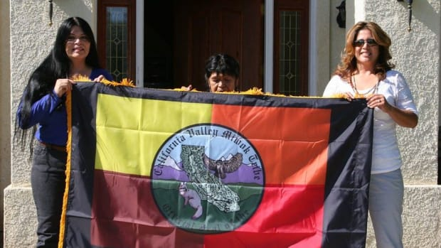 Pictured: California Valley Miwok Tribe Chairperson Silvia Burley, Tribal Elder/Certified Indian Artisan Mildred Burley and Cultural Arts and Crafts Coordinator Daveen Williams display Tribal Flag that is to be sent to the National Museum of the American Indian in Washington DC. Photo taken on October 18, 2011 at the tribal office in Stockton, California.