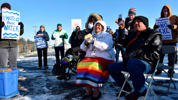 In this Oct. 29, 2019 file photo, opponents of the Keystone XL oil pipeline from Canada demonstrate in sub-freezing temperatures in Billings, Mont. Alberta is investing $1.1 billion in the disputed Keystone XL pipeline, a project that Alberta Premier Jason Kenney says is crucial for the province's economy. (AP Photo/Matthew Brown, File)