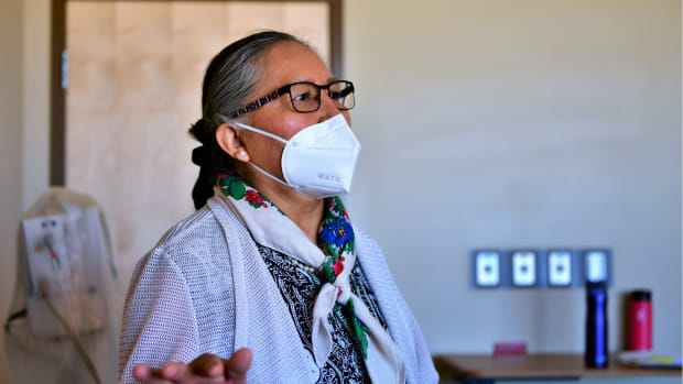 Wanda Begay, RN, Chief Nurse Executive speaks about her experience with COVID-19 patients at the Kayenta Health Center, Kayenta, AZ. Photo by