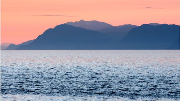 """Around the summer solstice at night in much of Alaska, the sun lingers just below the horizon, creating """"civil twilight,"""" when there's enough natural light to carry out most outdoor activities. Sunset in Alaska by Mark Byzewski (Courtesy of Creative Commons)"""