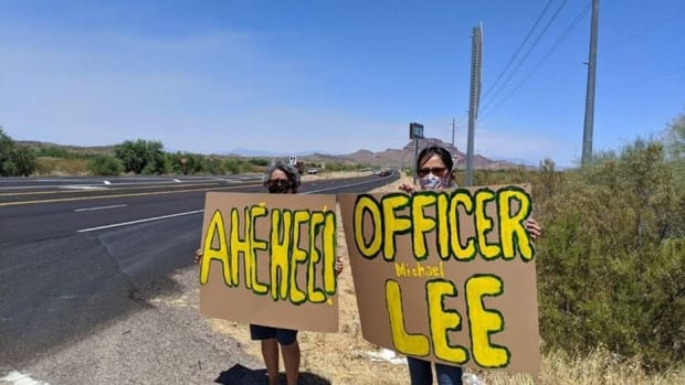 People stand along the procession route as Lee's body is transported Friday, June 19, from Banner University Medical Center in Phoenix to Rollies Mortuary in Gallup, New Mexico. (Photo provided by the Navajo Police Department Facebook