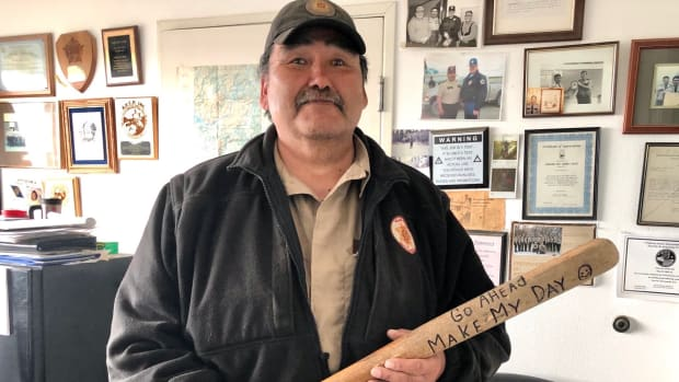"""Sgt. Daniel Max Olick kept a bat in his office as a joke. He didn't carry a gun. He told the Association of VIllage Council Presidents, """"if I shoot someone here in Kwethluk, that's a person I know. And I don't think I can live with that."""" Also, he said people know VPSOs are unarmed, which helps de-escalate situations. After 37 years on the job, he retired in May 2020 as the longest serving Village Public Safety Officer in the history of the statewide program. (Photo courtesy of Association of Village Council Presidents: File)"""