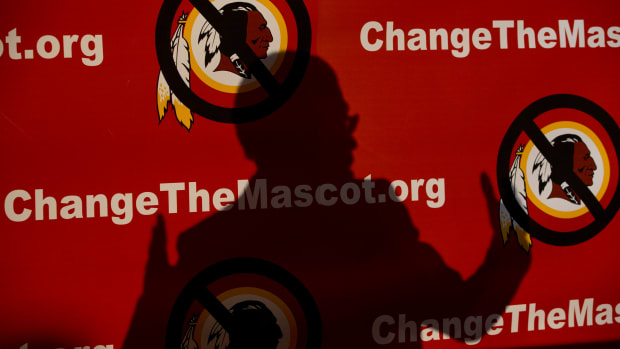 The shadow of Del. Eleanor Holmes Norton, D-D.C., is cast on the backdrop during the Oneida Indian Nation's Change the Mascot symposium, Monday, Oct. 7, 2013, in Washington, calling for the Washington NFL football team to change its name. (AP Photo/Carolyn Kaster)