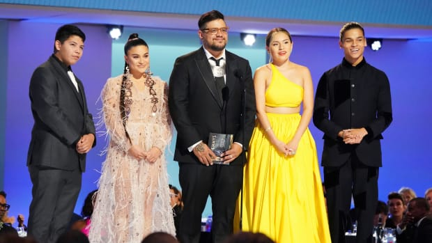 Lane Factor, from left, Devery Jacobs, Sterlin Harjo, Paulina Alexis and D'Pharaoh Woon-A-Tai present the award for outstanding directing for a limited or anthology series or movie at the 73rd Emmy Awards on Sunday, Sept. 19, 2021 at the Microsoft Theater in Los Angeles. (Photo by Jordan Strauss/Invision for the Television Academy/AP Images)