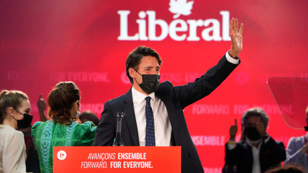 Liberal Leader Justin Trudeau greets supporters prior to his victory speech at Party campaign headquarters in Montreal, early Tuesday, Sept. 21, 2021. (Paul Chiasson/The Canadian Press via AP)