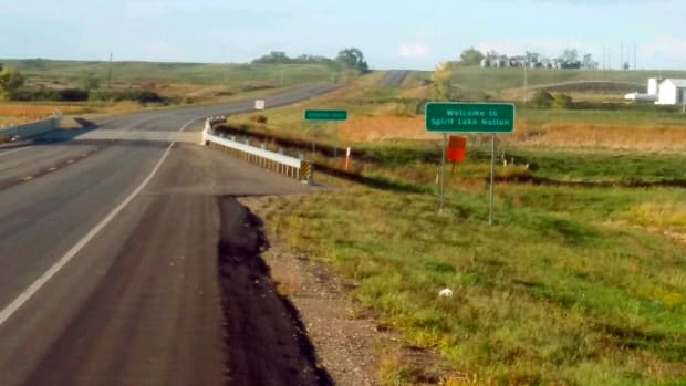 This Tuesday, Sept. 21, 2021 photo provided by Spirit Lake Tribal Chairman Doug Yankton shows a new sign marking the southern border of the reservation near the town of Sheyenne, N.D. The state Department of Transportation remapped and replaced all the signs at the reservation's major ports of entry after they moved in recent years primarily because of ongoing flooding of a lake on the northern part of the territory. The tribe had tried unsuccessfully for nearly two decades to get the markers in their rightful place. (Doug Yankton via AP)
