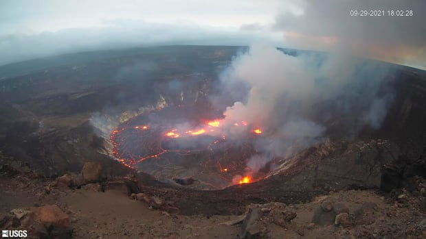 This webcam image provided by the United States Geological Survey shows a view of an eruption that has begun in the Halemaʻumaʻu crater at the summit of Hawaii's Kīlauea volcano, Wednesday, Sept. 29, 2021. (USGS via AP)