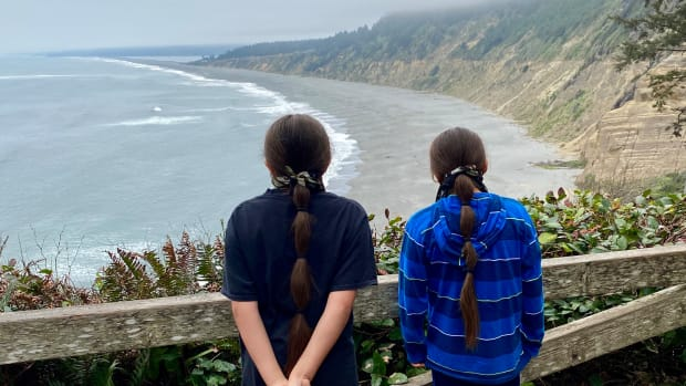 """Skip Lowry is a Yurok descendent and community organizer who advocated for the restoration of the name """"Sue-Meg"""" state park in Northern California. His sons look over the park. (Photo courtesy of Skip Lowry)"""