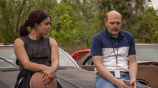 """RESERVATION DOGS """"California Dreamin'"""" Episode 7 (Aired, Monday, September 13) Pictured: (l-r) Devery Jacobs as Elora Danan, Bill Burr as Coach Bobson. CR: Shane Brown/FXCopyright 2021, FX Networks. All rights reserved."""