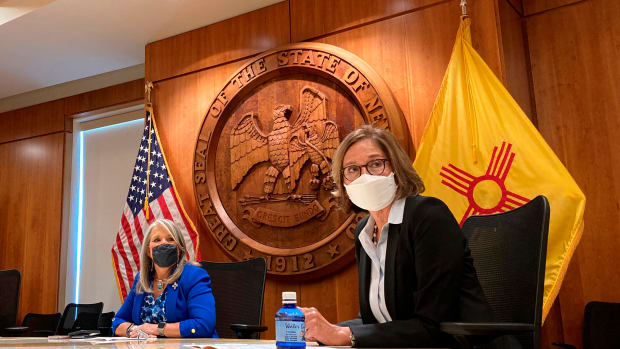 """FILE - In this Aug. 10, 2021, file photo, recently retired state Supreme Court Justice Barbara J. Vigil, right, appears at a news conference in Santa Fe, N.M., as Gov. Michelle Lujan Grisham looks on. In her first public address Tuesday, Oct. 12, 2021, Vigil, the new leader of New Mexico's child protection department pledges to restore the agency's credibility, and support new legislation that would increase accountability and strengthen laws protecting tribal children in adoption and fostercare. """"We must restore the credibility of CYFD,"""" said Vigil, secretary of the New Mexico Children Youth and Families Department. (AP Photo/Morgan Lee, File)"""