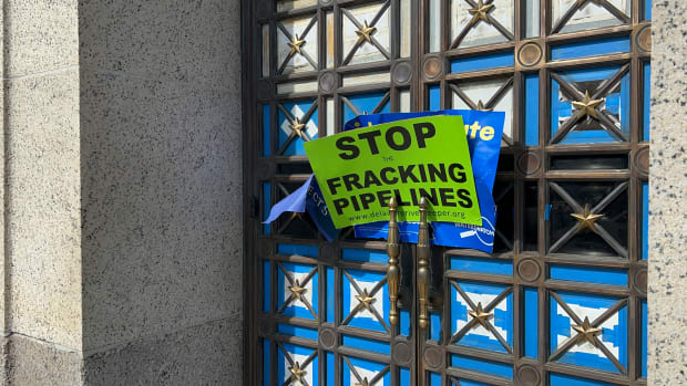 """""""Stop the fracking pipelines"""" sign on the Interior door. (Photo by Jourdan Bennett-Begaye, Indian Country Today)"""