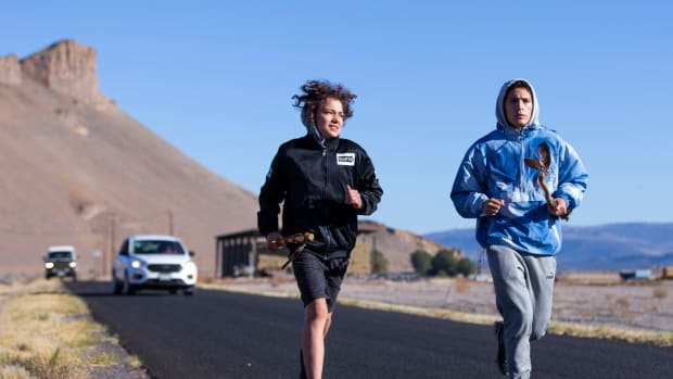 Christian Jackson, left, and Blaiwas Eaglepipe run a leg of the annual Modoc Ancestral Run on Oct. 9 with The Peninsula in the background. (Photo by Arden Barnes, (Klamath Falls) Herald and News)