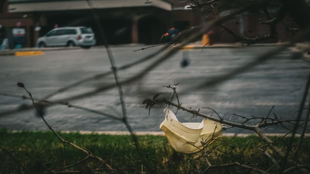 During the COVID-19 pandemic patients and visitors have been arriving at the hospital wearing masks, gloves, and all sorts of protective gear - many items are discarded in the parking lot and surrounding area in McLaren Central Michigan. (Photo courtesy of Dan Gaken, Creative Commons)