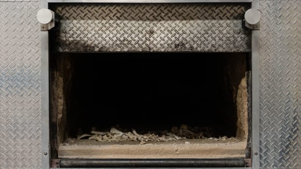 Cremated remains lie in the incineration chamber at the Paradise Memorial Crematory in Scottsdale, one of the state's largest. Partly fueled by the pandemic, the U.S. cremation rate reached 56 percent in 2020; it was 67 percent in Arizona. (Photo by Kevin Pirehpour/Cronkite News)
