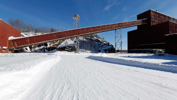 A former iron ore processing plant near Hoyt Lakes, Minnesota, shown here on Feb. 10, 2016, would become part of a proposed PolyMet copper-nickel mine. The Fond du Lac Band is fighting the mine in court, saying it would pollute the waterways. (AP Photo/Jim Mone)