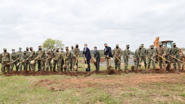 Pictured: Members of the Oklahoma Air National Guard, Army National Guard, Navy Reserve and Air Force Reserve Command were on hand for the groundbreaking of a Cherokee veterans housing initiative in Tahlequah Monday along with, center from left: Master Sgt. Mitchell Sisco, Innovative Readiness Training program operations manager; retired Brigadier General Brent Wright; Cherokee Nation Principal Chief Chuck Hoskin Jr.; and Deputy Principal Chief Bryan Warner. The participating military units will provide personnel to construct the 21 new homes as part of the U.S. Department of Defense Innovative Readiness Training program.