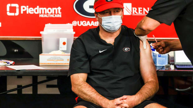 The improved access of the COVID-19 vaccine has raised interesting ethical question in the sports world, including should getting the vaccine, as Georgia coach Kirby Smart is here, be mandated and should athletes be prioritized. (Photo courtesy of Piedmont Healthcare via Cronkite News)