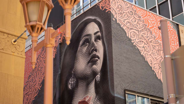 """The black-and-white portrait of a teenage girl from Phoenix's Salt River Pima-Maricopa Indian Community is a break from historic photos that """"romanticize Native people and kind of keep us in a time capsule,"""" the artists say. (Photo by Sofia Fuentes/Cronkite News)"""