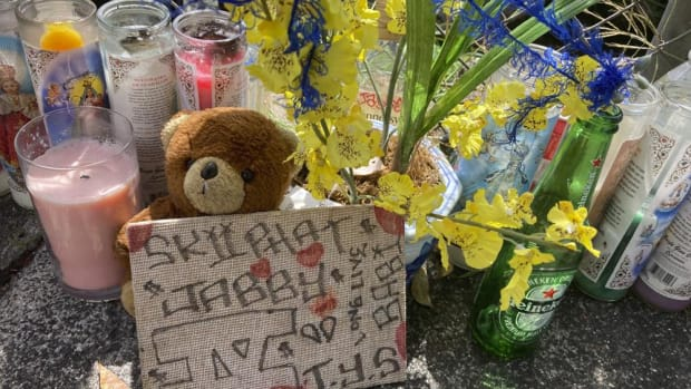 In this Wednesday, April 28, 2021, photo a stuffed bear is among the items left at a street memorial where Honolulu Police shot and killed 16-year-old Iremamber Sykap, whose nickname was Baby, during a car chase on Kalakaua Ave., in Honolulu. Some in Hawaii's Micronesian community say the shooting highlights the racism they face. (AP Photo/Jennifer Sinco Kelleher)