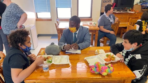 New Mexico Public Education Secretary Ryan Stewart had lunch with students in April when he visited Wagon Mound Elementary. (Photo courtesy of New Mexico Public Education Department Facebook)