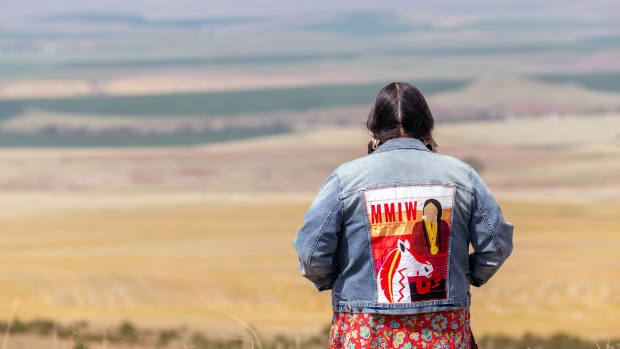 Mildred Quaempts, who lost three female members of her family to unsolved murders or disappearances, stands on a hill near her home on the Umatilla Indian Reservation. (Photo by Kathy Aney, Underscore)