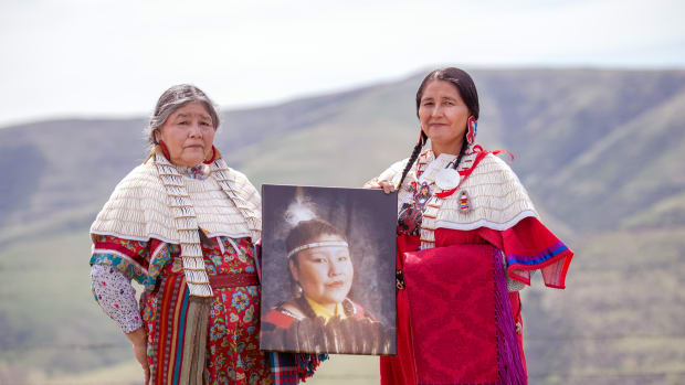 Mildred Quaempts and Merle Kirk hold a portrait of Mavis Kirk-Greeley, who died in 2009 after her boyfriend allegedly deliberately hit her with his vehicle on the Warm Springs Indian Reservation. Kirk-Greeley is Quaempts' daughter and Kirk's sister. (Photo by Kathy Aney, Underscore)