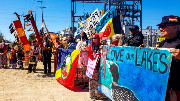 Water protectors in Mackinaw City, Michigan, protest Enbridge's Line 5 on May 13, 2021. (Photo courtesy of Whitney Gravelle)