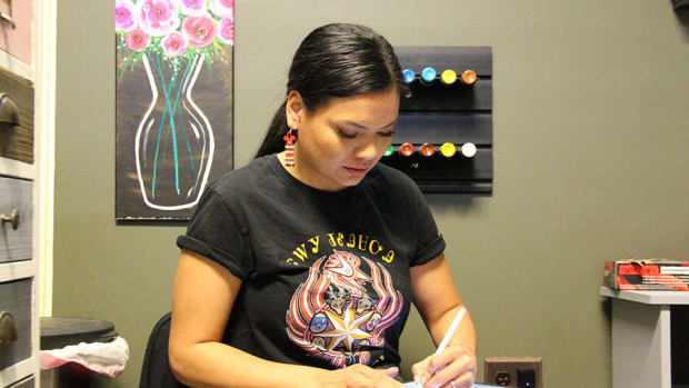 Cherokee Nation citizen and tattoo artist Nathalie Standingcloud works on a design for a client at Inkjunkys Tattoo studio on March 18, 2021 in Tulsa, Oklahoma. (Photo courtesy of Cherokee Phoenix via Lindsey Bark)