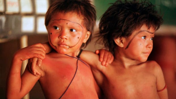 FILE - In this March 22, 1998 file photo, Yanomami children stand arm in arm in the village of Demini in the Amazon jungle, Brazil. On Monday, May 24, 2021, a Supreme Court justice ordered the government to protect Indigenous populations, including the Yanomami, threatened in recent weeks by illegal miners who appear to have been emboldened by support for their industry from President Jair Bolsonaro. (AP Photo/Dario Lopez-Mills, File)