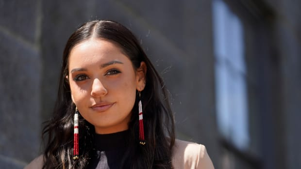 """Samantha Maltais, of New Bedford, Mass., an incoming Harvard Law student, stands for a photograph, Tuesday, May 25, 2021, in New Bedford. When Maltais steps onto Harvard's campus this fall, she'll become the first member of the Aquinnah Wampanoag tribe to attend its prestigious law school. """"Coming from a tribal community in its backyard, I'm hyper aware of Harvard's impact,"""" said Maltais, the 24-year-old daughter of her tribe's chairwoman. (AP Photo/Steven Senne)"""