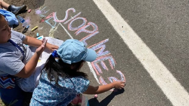 Children joined in the protest of Enbridge's Line 3 pipeline project with chalk drawings on Monday, June 7, 2021, in northern Minnesota. (Photo by Mary Annette Pember, Indian Country Today)