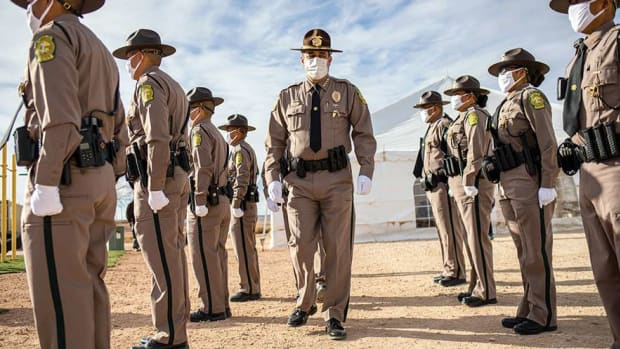 Navajo Police Chief Philip Francisco walks down a roll of newly recruited police officers at the Navajo Police Training Academy on Jan. 2 in Chinle, Arizona.(Photo by Sharon Chischilly/Navajo Times)