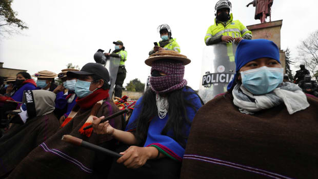 Misak Indigenous people take part in an anti-government protest triggered by proposed tax increases on public services, fuel, wages and pensions, in Bogota, Colombia, Wednesday, June 9, 2021. (AP Photo/Fernando Vergara)