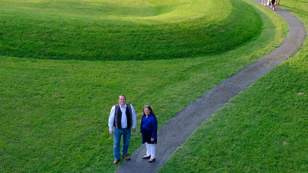Ben Barnes, chief of the Shawnee Tribe and Glenna Wallace chief of the Eastern Shawnee Tribe of Oklahoma pause at the entrance to the Great Serpent Mound in Peebles, Ohio (Photo by Mary Annette Pember)