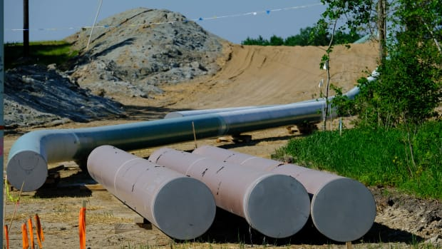 Pipes lie on the surface waiting to be installed along Enbridge Line 3's route near Park Rapids, Minnesota, on June 6, 2021. (Photo by Mary Annette Pember/Indian Country Today)