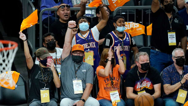 Phoenix Suns fans cheer a score during the first half of Game 1 of the NBA basketball Western Conference finals against the Los Angeles Clippers, Sunday, June 20, 2021, in Phoenix. (AP Photo/Ross D. Franklin)