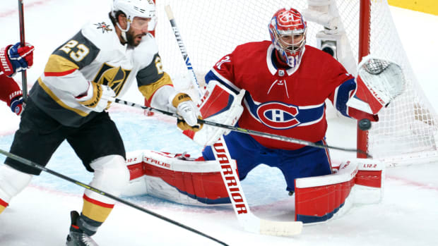 Vegas Golden Knights' Alec Martinez (23) tries to deflect a shot past Montreal Canadiens goaltender Carey Price during the second period in Game 6 of an NHL hockey Stanley Cup semifinal playoff series Thursday, June 24, 2021 in Montreal. (Paul Chiasson/The Canadian Press via AP)