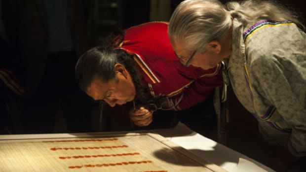 Haudenosaunee Tadadaho (head chief) of all the Six Nations, Sid Hill, and Faithkeeper Oren Lyons, examine the encased Treaty of Canandaigua on the day it was installed in the Nation to Nation exhibition, September 2014. Their ancestors witnessed and signed the Treaty, and their DNA is on it. (Photo: National Museum of the American Indian)