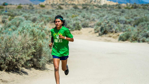 Ku Stevens runs on a road not far from the Stewart Indian School near Carson City in this photo taken on June 18, 2021. The Yerington High School cross-country runner plans to retrace later this summer route his great-grandfather took when he escaped from the school to his home in Yerington. (Ed Andersen/ Lyon County News Leader via AP)