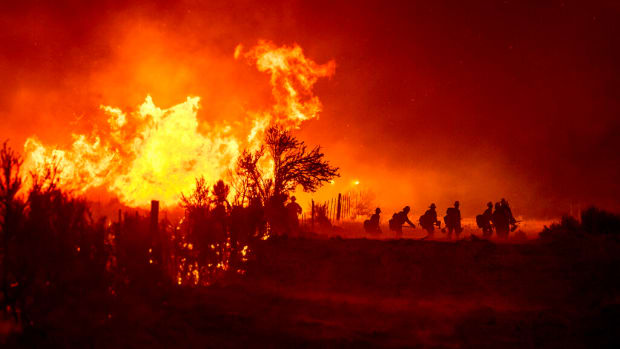 As of July 17, 2021, the Beckwourth Complex Fire has consumed 105,000 acres and is 68 percent contained. Shown here on July 9, firefighters battle the Sugar Fire, part of the Beckwourth Complex Fire, in Doyle, Calif.(AP Photo by Noah Berger).