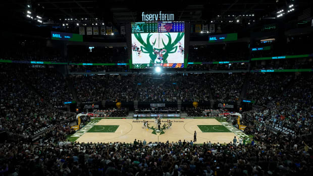 The Milwaukee Bucks and the Phoenix Suns tip off for the start of Game 3 of basketball's NBA Finals in Milwaukee, Sunday, July 11, 2021. (AP Photo/Paul Sancya)