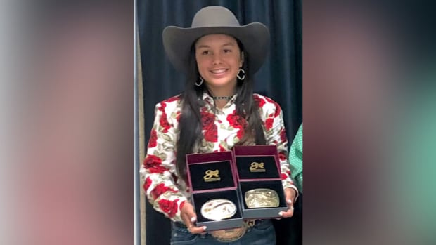 Cherokee Nation citizen Karlee Jennings, 13, holds two championship buckles she won at a recent barrel-racing competition. (Photo courtesy of Cherokee Phoenix)