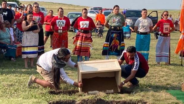 Members of the Sicangu Youth Council help provide a formal burial at the Rosebud Indian Reservation on July 17, 2021, for some of the nine Rosebud students who died at Carlisle Indian Industrial School in the 1880s. The children's remains were finally returned to their homelands after 140 years, wrapped in a buffalo robe bundle and placed in a cedar box. Earth collected at the Carlisle graves were added to the children's final resting places. (Photo by Vi Waln for Indian Country Today)