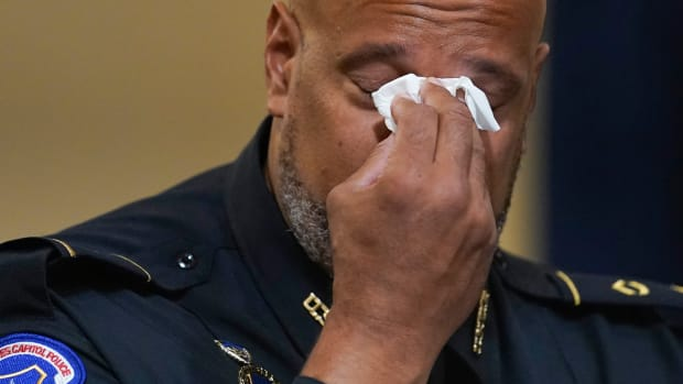 U.S. Capitol Police Sgt. Harry Dunn wipes his eyes during the House select committee hearing on the Jan. 6 attack on Capitol Hill in Washington, Tuesday, July 27, 2021. (AP Photo/ Andrew Harnik, Pool)