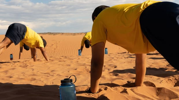 Navajo Nation Police recruits stretch after running on sand dunes for physical training in Chinle, Arizona, on the reservation. A recent report said the 200-member department needs hundreds more officers to do its job. (Photo by Beth Wallis/ News21)