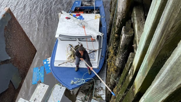 A Mi'kmaw harvester securing her boat back to the wharf after the lines were cut. (Photo by Angel Moorem APTN)