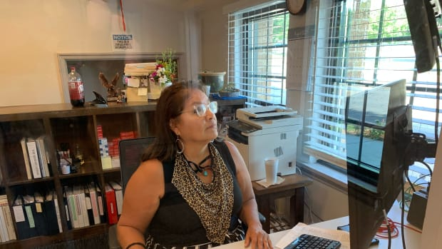 Kim Holmes at work in her office at the Altamont Apartment complex in Tulsa where she works as a property manager for the Mental Health Association of Oklahoma. (Gaylord News photo/ John Gott)