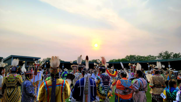 The final grand entry at the old Twin Buttes North Dakota powwow grounds. (Photo by R. Vincent Moniz, Jr.,ICT)