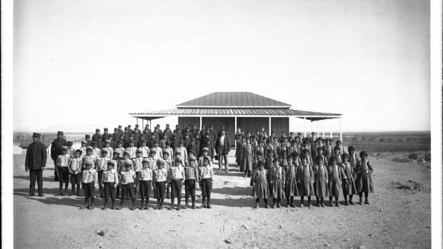 Children from the Quechan tribe stand in lines outside the federal government Indian School in Yuma, Ariz., in this historical photo taken circa 1900. (Photo by C.C. Pierce, University of Southern California Libraries and California Historical Society via Howard Center for Investigative Journalism)